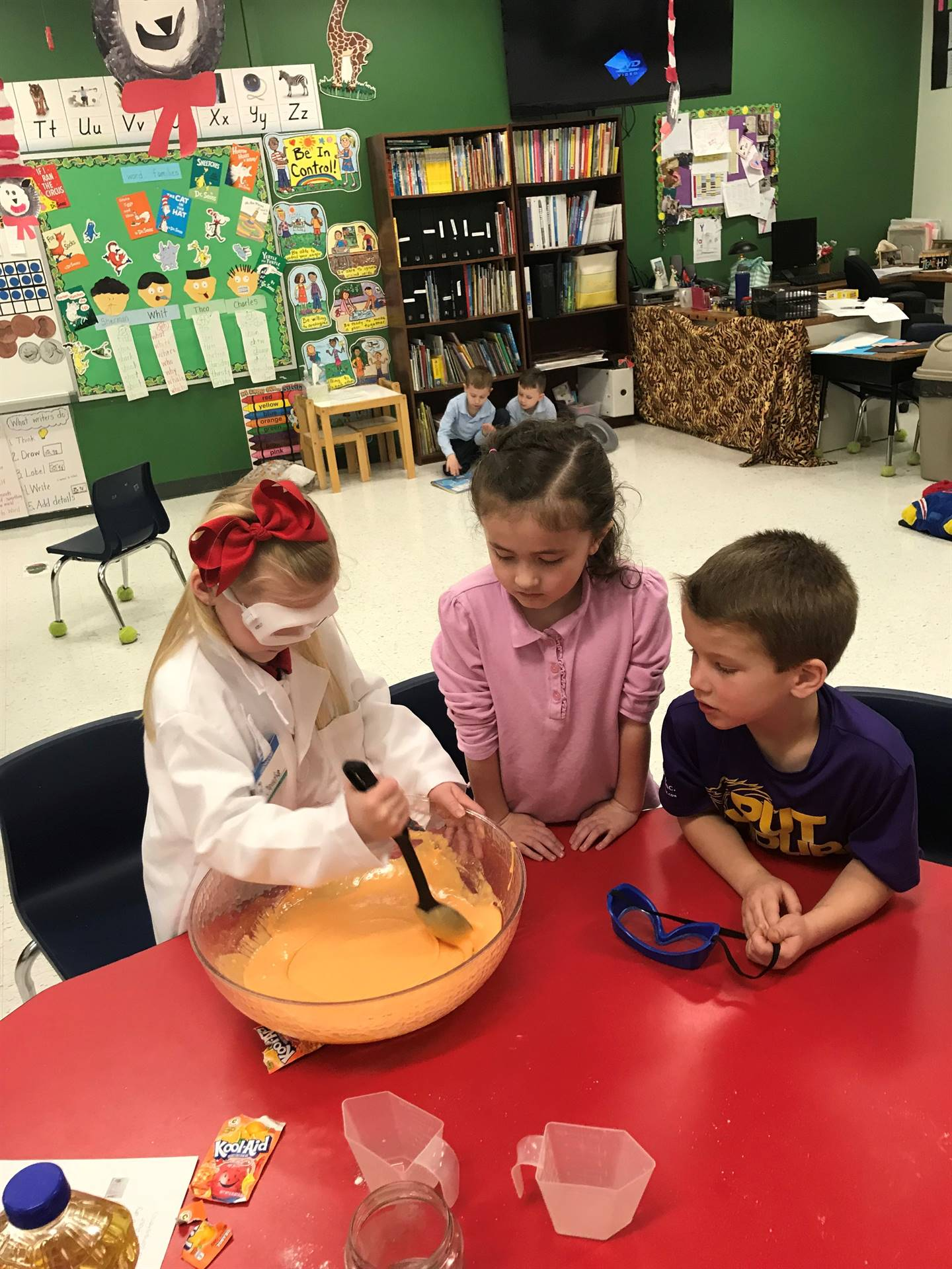 Kindergarteners mixing something in a bowl