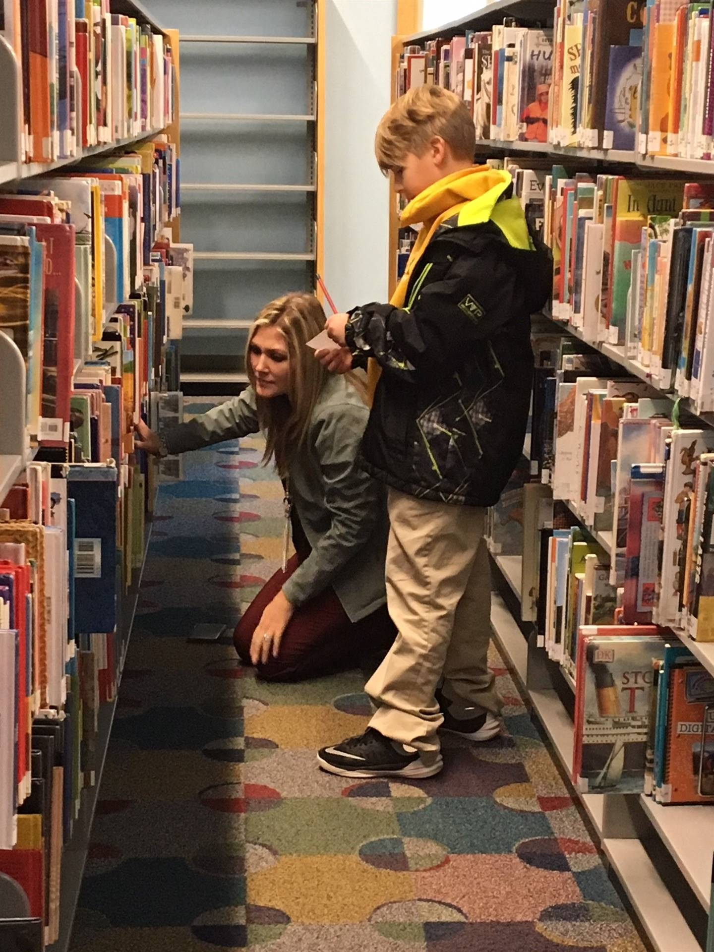 Student and teacher in a library