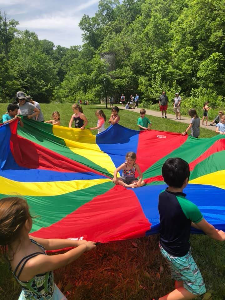 Kindergarten students with parachute